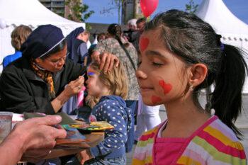 Nuns painting children's faces