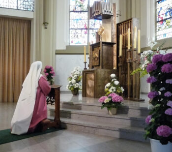 Sister of Perpetual Adoration before Jesus in the Eucharist