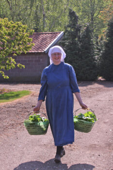 SSpS Sister in Steyil Carrying Baskets of Vegetables