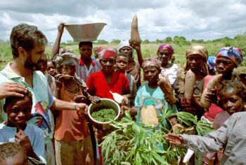 Community Member in Angola Showing the Harvest Products