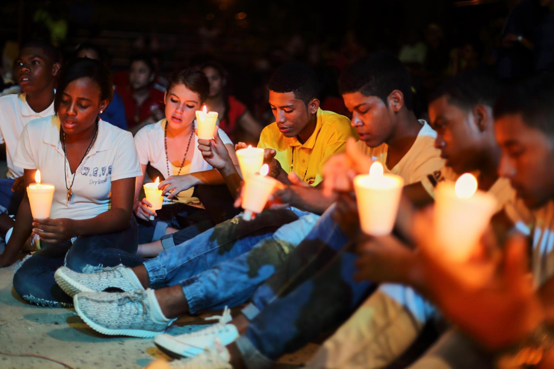 Young people praying at Our Lady of Carmen Parish in Bocas del Toro, Panama