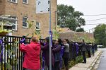 Group of Women Decorating with Violet Ribbons the front of the Holy Spirit Life Learning Center, of the SSpS Missionaries